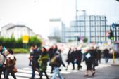Blurred city and people — Stock Photo