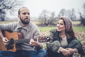 Couple in love  with guitar — Foto Stock