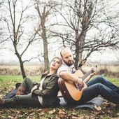 Couple in love  with guitar — Foto de Stock