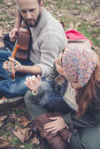 Couple in love  with guitar — Стоковое фото