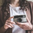 Close up of hands woman with old camera — Stock Photo