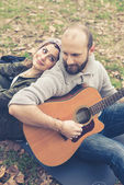 Couple in love  with guitar — Zdjęcie stockowe