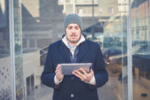 Multitasking man using tablet, laptop and cellhpone — Stock Photo