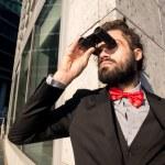 Stylish elegant dreadlocks businessman binoculars — Stock Photo #40147481