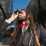 Stylish elegant dreadlocks businessman binoculars — Stock Photo #40148109