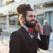 Stylish elegant dreadlocks businessman — Stock Photo