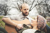 Couple in love  with guitar — Stock Photo