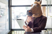 Man in horse mask — Stock Photo