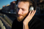 Bearded man  listening music — Stock Photo