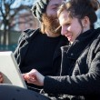 Stock Photo: Couple using tablet