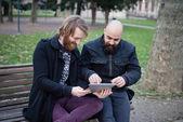 Bearded man using tablet — Stock Photo