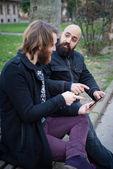 Bearded mans using tablet — Stock Photo