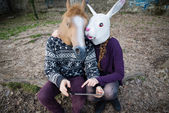 Cuople in masks using tablet — Stock Photo