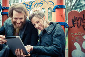 Young  couple using tablet — Stock Photo