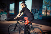 Punk girl riding bike — Foto Stock