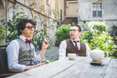 Two  hipsters drinking tea — Stok fotoğraf