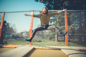Man jumping on trampoline — Stock Photo