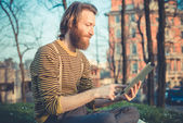 Hipster man using tablet — Stock Photo