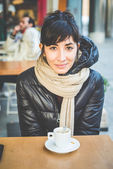 Woman at the coffee bar — Stock Photo
