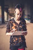 Punk girl using tablet — Stock Photo