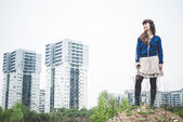 Woman in urban landscape — Stock Photo