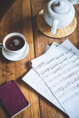 Sheet music and teapot — Stock Photo