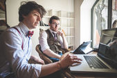 Two young hipster stylish men working  — Stock Photo