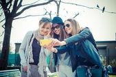 Three beautiful friends authentic — Стоковое фото
