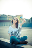 Woman with smart phone — Stock Photo
