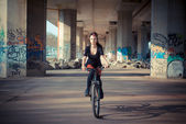 Punk girl riding bike — Stockfoto