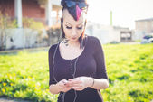 Punk girl listening music — Stock Photo