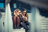 Two women using smartphone — Stock Photo