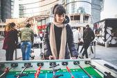 Woman playing table football — Photo