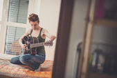 Lesbian  woman playing guitar — Stock Photo