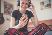 Lesbian  listening to music — Stock Photo