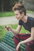 Woman using smart phone — Stock Photo