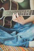 Woman hands playing guitar — Stock Photo
