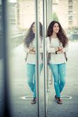 Beautiful curly long brunette hair moroccan woman — Zdjęcie stockowe