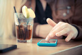 Close up of woman hands using smart phones — Stock Photo