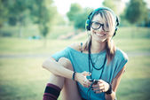 Young beautiful model woman listening music — Stock Photo