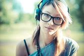 Young beautiful model woman listening music — Foto Stock