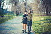 Young modern stylish couple using tablet urban — Stock Photo