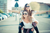 Two beautiful young women having fun — Stock Photo