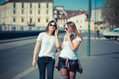 Two beautiful young women walking — Stock Photo