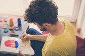 Handsome hipster modern man painting — Foto Stock
