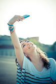 Young beautiful brunette woman selfie with smart phone — Stock Photo