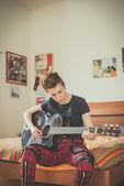 Lesbian  woman playing guitar — Stock Photo
