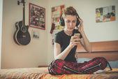 Lesbian woman listening to music — Stock Photo