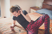 Lesbian  woman listening to music — Stock Photo