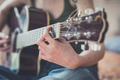 Close up of woman hands playing guitar — Stock Photo